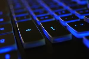 closeup-photo-of-black-and-blue-keyboard-1194713