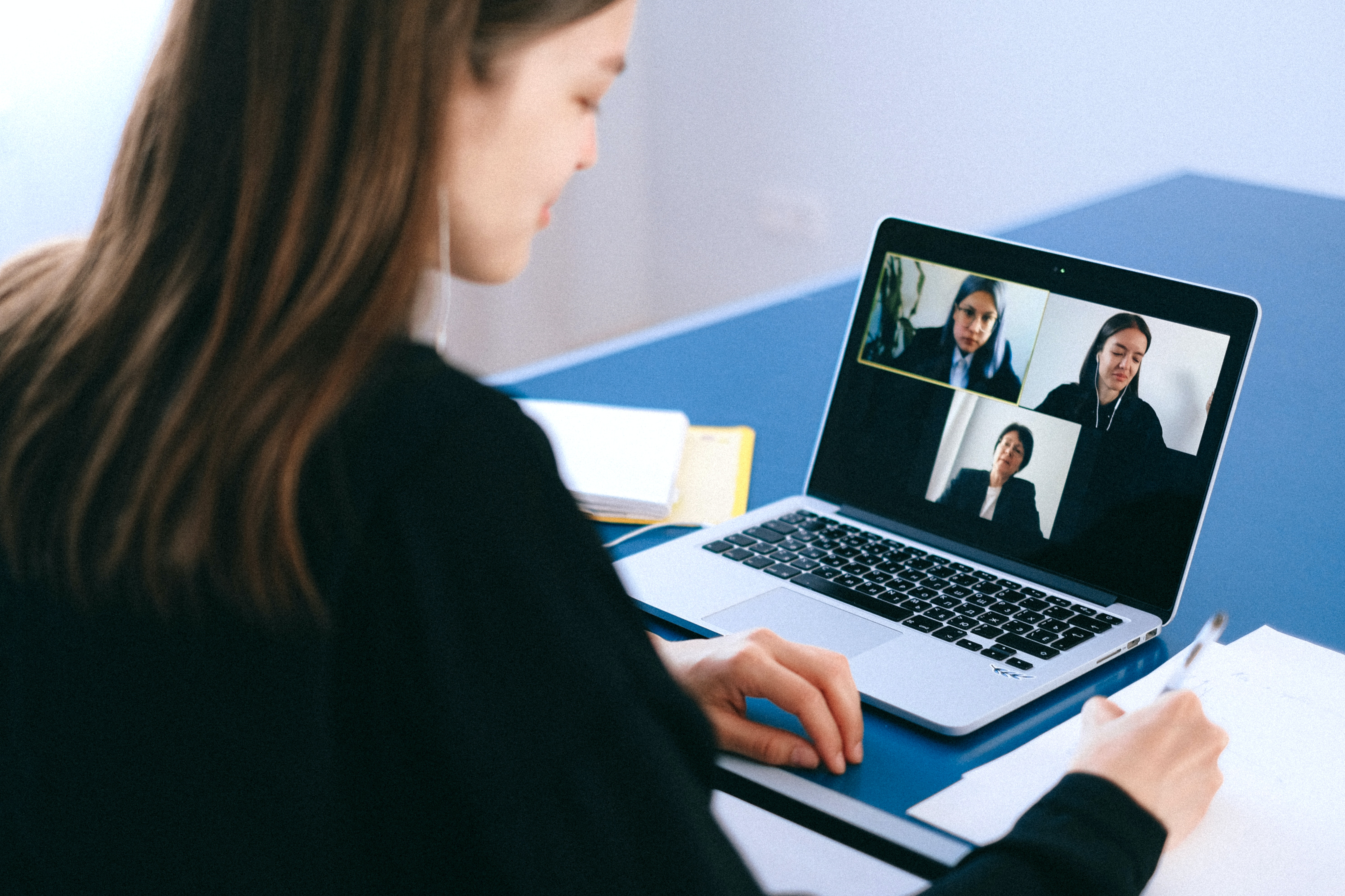 microsoft teams vs zoom conferencing laptop woman video call