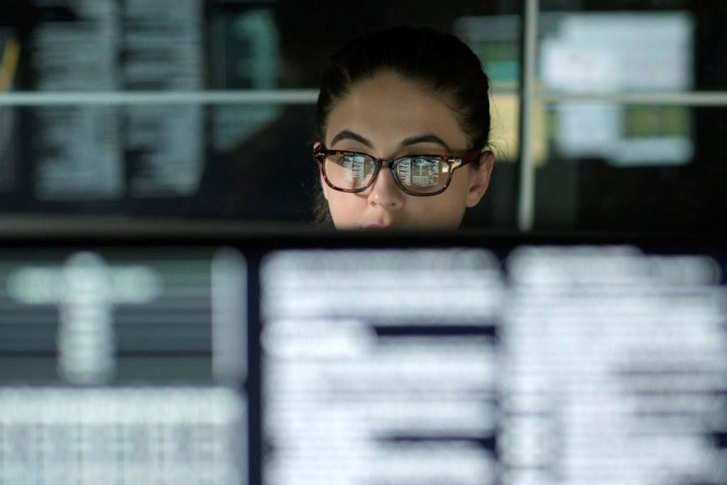 woman glasses computer gcc high microsoft teams